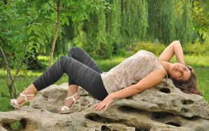 relaxing on the stones by girls-n-stylestock