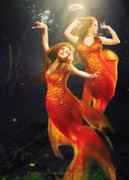 Dancing gold fishes by PushinkaArt