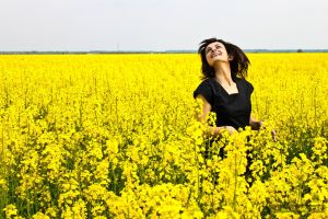 Happy Young Woman In The Yellow Field by matejpaluh