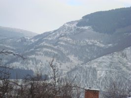Winter view of the cliffs above Tserovo by WolfDemonG