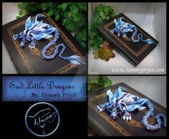 Blue Dragon on Large Wooden book by Tpryce