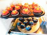 Elmo and Cookiemonster Cupcakes by cheshirefran