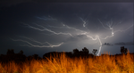 lightning over the grass by kalascee