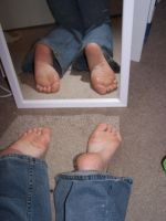 Both Feet In The Mirror by Della-Stock