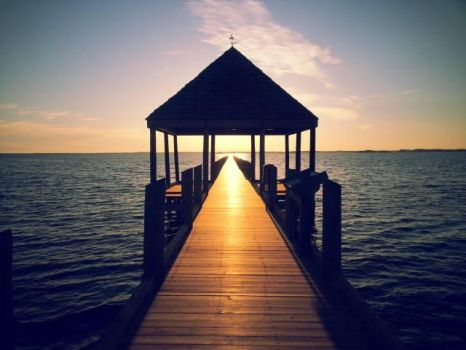 Ocean Sunset Beyond The Covered Pier By Trinity Ro by Trinity-Rose