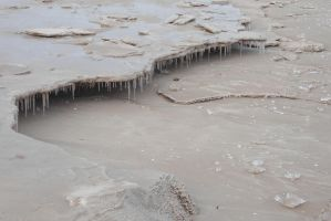 icicles in the sand by Un-Pc