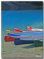Canoes on Moraine Lake by Ann75