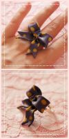 purple lolita ribbon ring by Fraise-Bonbon