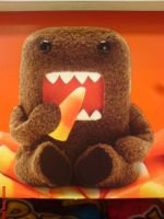 Domo Eating a Candy Corn by crazyazianfosho