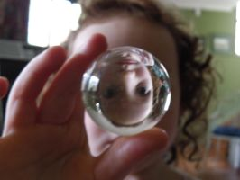 Caity through glass ball by Shadowrenderer