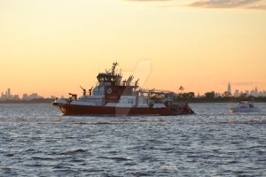 NYFD on bay at sunset 2 by ArtieWallace