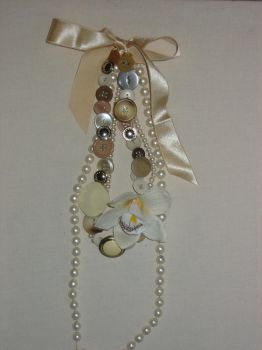 buttons and beads necklace in by littlemissmachine