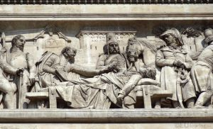 Stone historic scene at the Arc de Triomphe by EUtouring