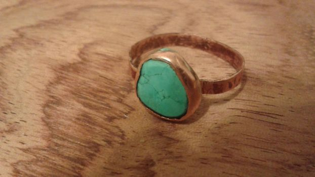 Small turquoise statement ring set in copper by woodwireandstone