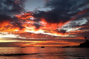 Firey sky over the water by isotophoto