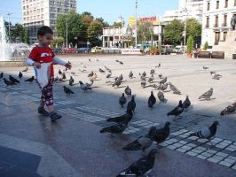 Child among pigeons by Kitty-Amelie
