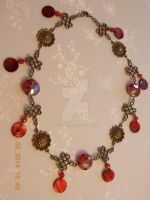 Bronze- coloured red crystal and shell necklace by Quested-Creations