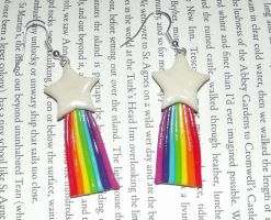 Glow in the dark shooting star earrings by MeticulousBlue