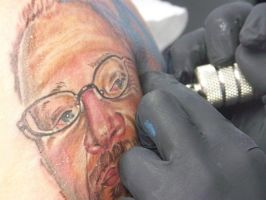 working by tattooneos