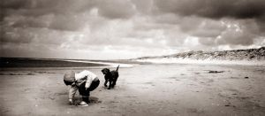 Boy and Dog on the Beach by speedonl