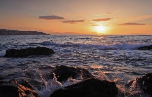 Sunset and Crashing Waves by Lairis77
