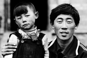 Tibetan Boy and Dad by Peanutsalad
