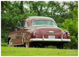 Rear View Of An Early 50's Chevy by TheMan268