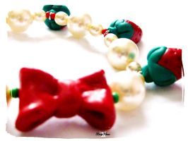 Red Bow Strawberry Bracelet by Cateaclysmic