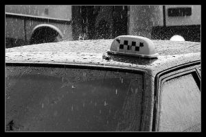 Yellow cab in monotone rain by ttttttttttt