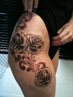 Roses on thigh by state-of-art-tattoo
