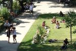 People relaxing in the square by EUtouring