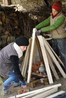 Paper furnace construction with wood by MissUmlaut