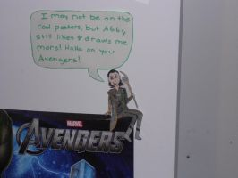 Loki sitting on my poster by JediSkygirl