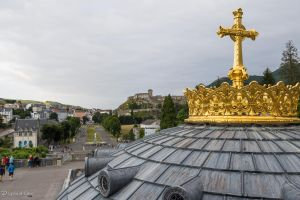 Gilded cross and dome of the Rosary Basilica by CyclicalCore