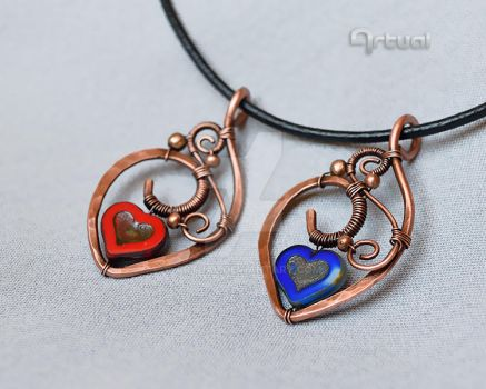 Handmade heart pendants by artual