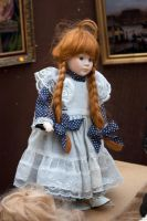 Red haired porcelain doll by steppelandstock