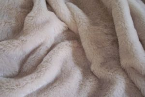 Soft furry fabric in folds by paintresseye
