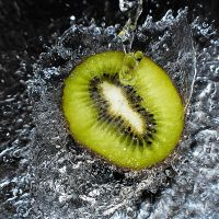 kiwi fruit splash by SaphoPhotographics