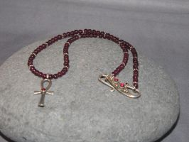 Ankh and Garnet Necklace by Spryteness