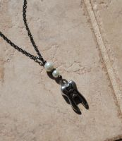 Shiney Tooth Necklace by kittykat01