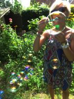 soap bubbles and sister by Deepblue-shines-on
