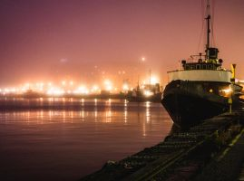 Night lights next to a boat. Industrial area. by hmcindie