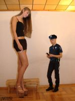 Tall Baltic girl and tiny cop by lowerrider