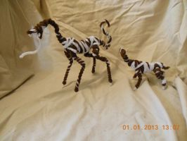 Pipecleaner Stilt Beast With Its Baby by psycholiger13