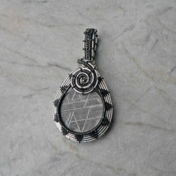Gibeon Meteorite in silver and hematite by magpie-poet