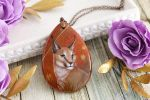 Caracal II - handmade painted stone pendant by LunarFerns