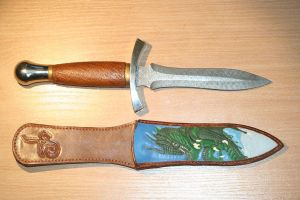 Damascus dagger and hand carved leather sheath by LeszekGyver