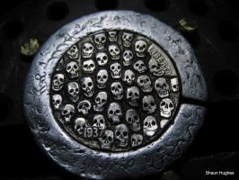 Carved Tiny Skull Coin by shaun750