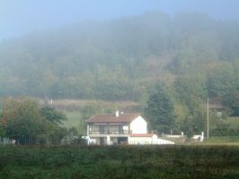 house in the morning fog by planzman
