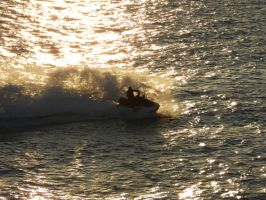 Jet Skiing through the sunset by andreibsc